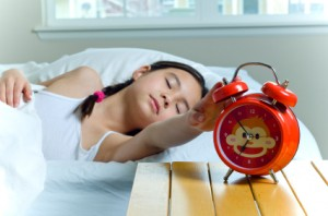 sleeping girl with alarm clock iStock_000008772524XSmall